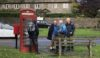 Ralph seeks instructions on how to use a public phone box