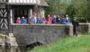U3A walkers on the bridge at Little Moreton Hall
