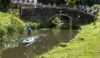 A lone paddleboarder passes the walkers at rest