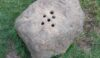 Boundary stone above Stoney Middleton with holes for vinegar and money